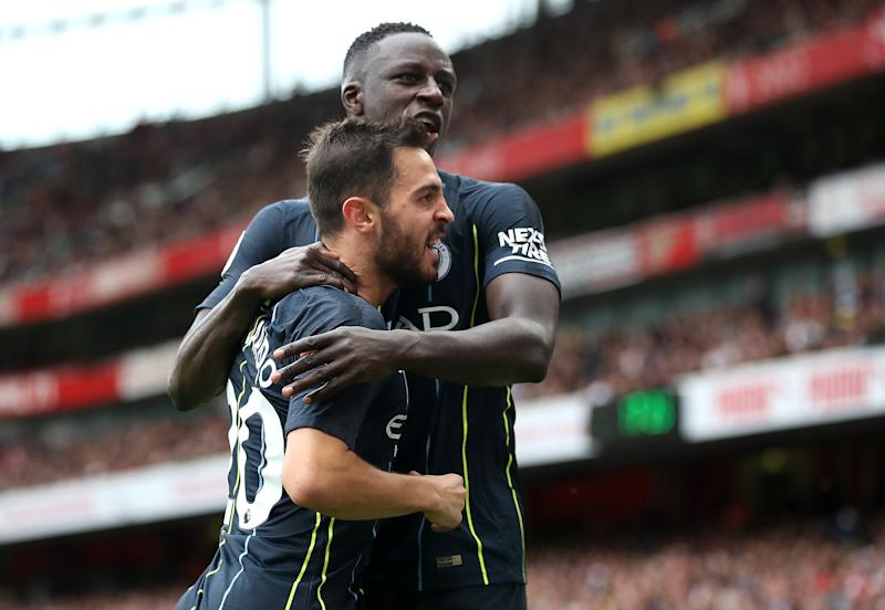 Manchester City's Bernardo Silva (left) celebrates with Benjamin Mendy after scoring his side's second goal of the game during the Premier League match at the Emirates Stadium, London. (Photo by Nick Potts/PA Images via Getty Images)
