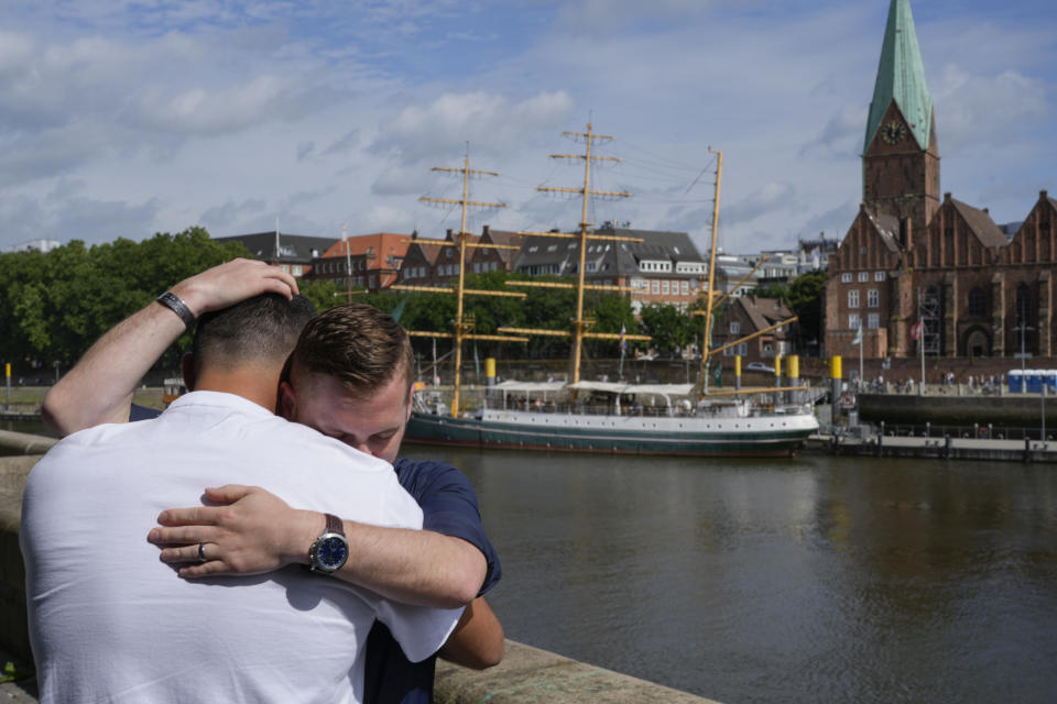 FILE - In this Aug. 14, 2021 file photo U.S. Army veteran Spencer Sullivan, right, and Abdulhaq Sodais, who served as a translator in Afghanistan, hug and cry during an interview in Bremen, Germany. Sullivan spent years fighting to get Sodais asylum after he risked his life aiding U.S. troops in Afghanistan during its 20-year war there and then was denied a U.S. visa. On Wednesday, Sept. 22, 2021, a German court granted Sodais asylum. (AP Photo/Peter Dejong, File)