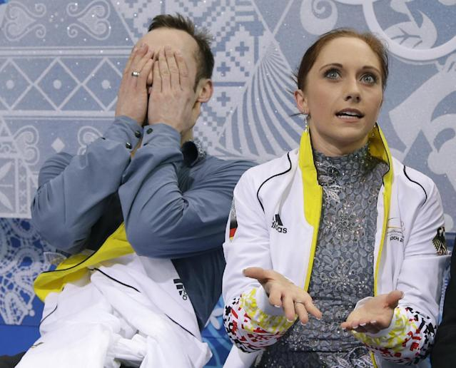 Maylin Wende and Daniel Wende of Germany wait in the results area after competing in the pairs short program figure skating competition at the Iceberg Skating Palace during the 2014 Winter Olympics, Tuesday, Feb. 11, 2014, in Sochi, Russia. (AP Photo/Darron Cummings)