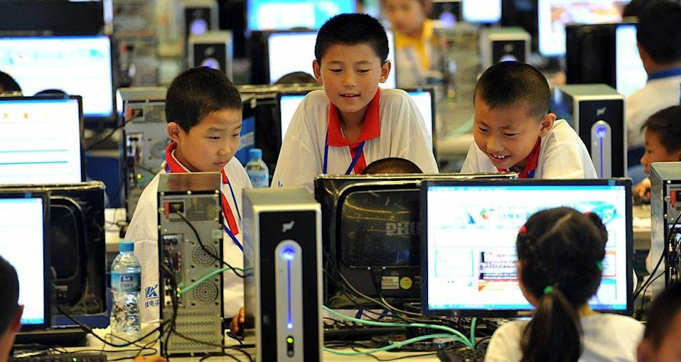 Chinese children attend a computer class to learn how to properly use the Internet, in Beijing on June 7, 2010. China defended its right to censor the Internet, saying it needed to do so to ensure state security, and cautioned foreign governments to respect and obey its online policies, as more than 400 million Chinese people are now online. CHINA OUT AFP PHOTO (Photo credit should read STR/AFP via Getty Images)
