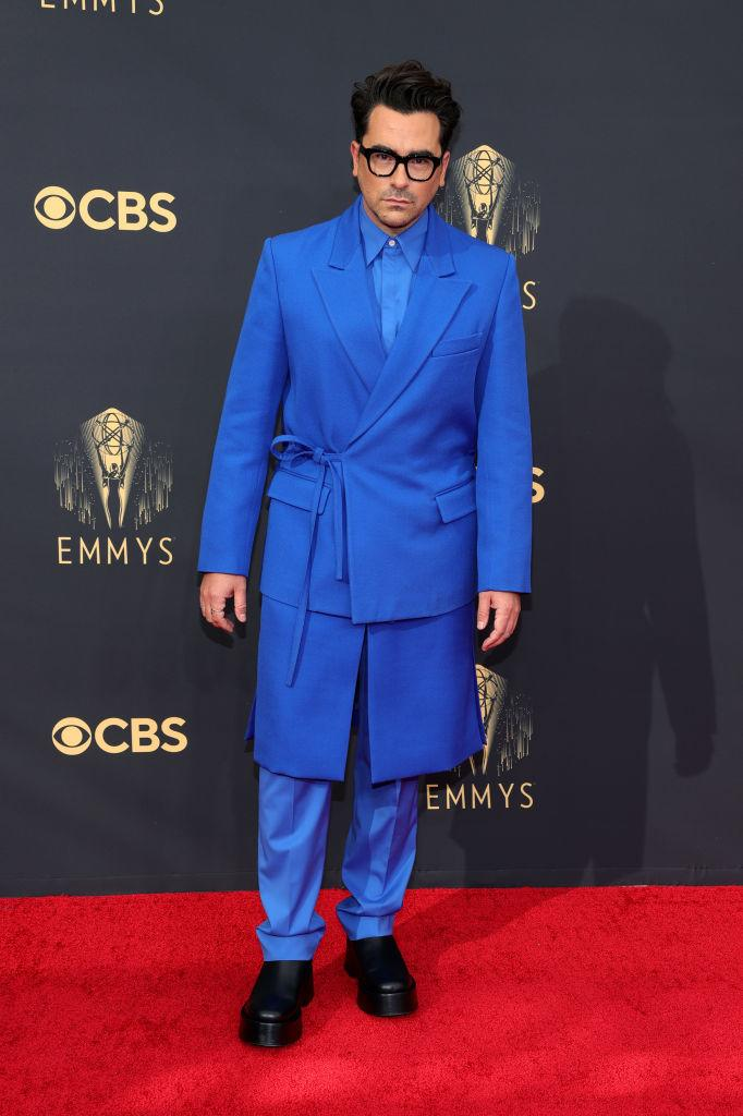 """<p>Fresh off of his turn on the Met Gala red carpet, the """"Schitt's Creek"""" star arrived to the Emmys wearing a bold blue look by Valentino<em>. (Image via Getty Images)</em></p>"""