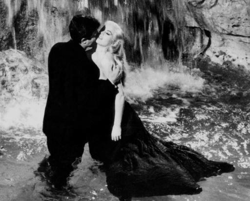 Fellini's extravagent films such as 'La Dolce Vita' entranced audiences in Italy and abroad alike