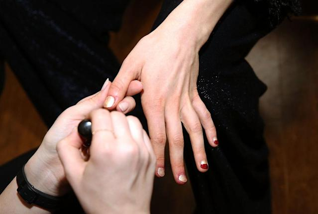 <p>To emulate the juxtaposition of British and Indian influences, lead manicurist for Zoya Naomi Gonzales employed a combination of gold metallic shimmer (Brooklyn) and deep red (Courtney) to represent the harmony of two cultures. (Photo by Robin Marchant/Getty Images) </p>
