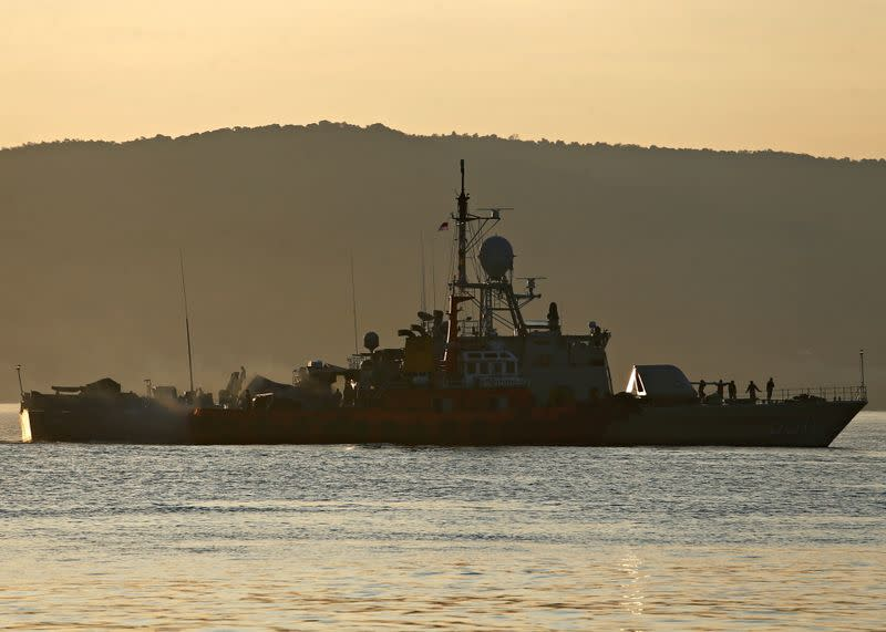 An Indonesian Navy's ship is seen at the Tanjung Wangi port as the search continues for the missing KRI Nanggala-402 submarine