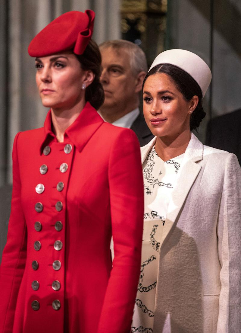 Britain's Meghan, Duchess of Sussex (R) and Britain's Catherine, Duchess of Cambridge, (L) attend the Commonwealth Day service at Westminster Abbey in London on March 11, 2019. - Britain's Queen Elizabeth II has been the Head of the Commonwealth throughout her reign. Organised by the Royal Commonwealth Society, the Service is the largest annual inter-faith gathering in the United Kingdom. (Photo by Richard Pohle / POOL / AFP) (Photo credit should read RICHARD POHLE/AFP via Getty Images)