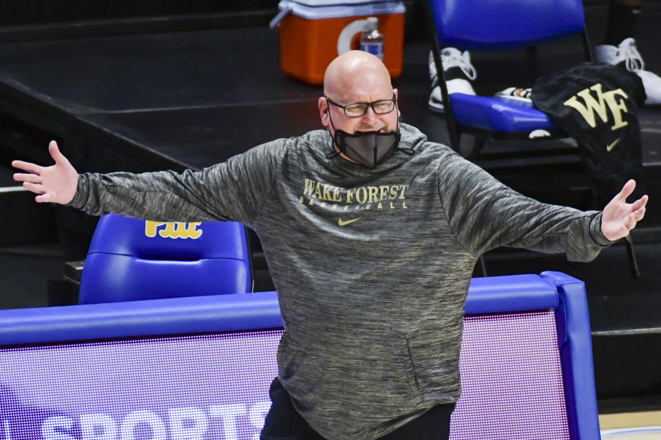Wake Forest head coach Steve Forbes gestures to his team during the first half of an NCAA college basketball game, Tuesday, March 2, 2021, in Pittsburgh. (AP Photo/Fred Vuich)