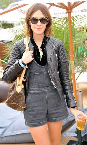 The Brit chic makes dungarees cool, teaming her denim combo with a leather biker jacket and heeled clogs.