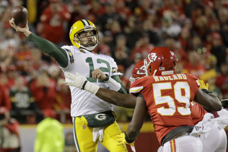 Green Bay Packers quarterback Aaron Rodgers (12) throws a pass under pressure from Kansas City Chiefs linebacker Reggie Ragland (59) during the first half of an NFL football game in Kansas City, Mo., Sunday, Oct. 27, 2019. (AP Photo/Charlie Riedel)