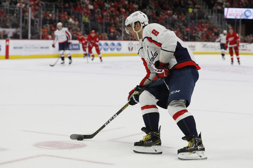 Washington Capitals left wing Alex Ovechkin scores an empty-net goal during the third period of the team's NHL hockey game against the Detroit Red Wings, Saturday, Nov. 30, 2019, in Detroit. (AP Photo/Carlos Osorio)