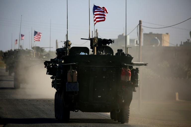 A convoy of US armoured vehicles drives past near the Syrian city of Manbij, which is held by the US-backed Syrian Democratic Forces, on March 5, 2017
