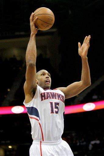 Atlanta Hawks center Al Horford (15) shoots in the first half of an NBA basketball game against the Chicago Bulls, Saturday, Dec. 22, 2012, in Atlanta. (AP Photo/Todd Kirkland)