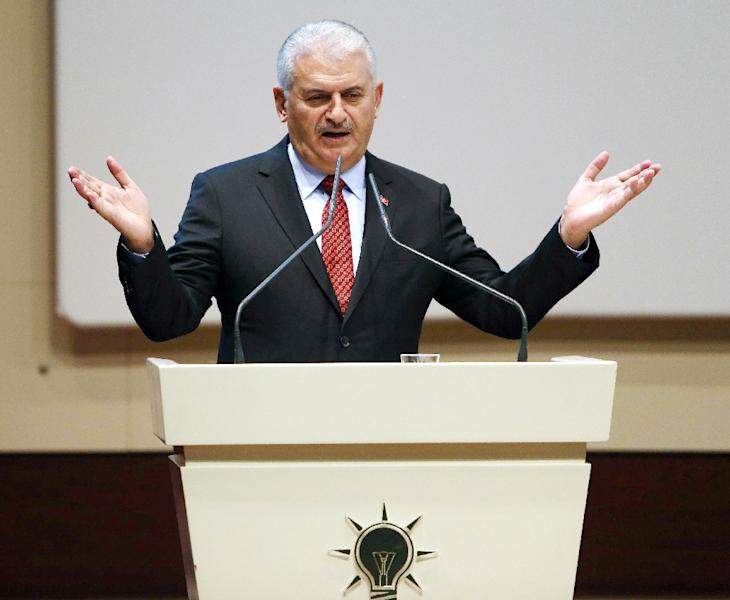 """Turkish Prime Minister Binali Yildirim vowed that the attacks would be """"given a response"""" and would not diminish the military's determination to remove """"terrorists"""" in the region (AFP Photo/Adem Altan)"""