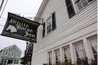 """<p>In operation for over 165 years, the <a href=""""https://www.tripadvisor.com/Restaurant_Review-g42464-d7285202-Reviews-The_White_Horse_Inn-Metamora_Michigan.html"""" rel=""""nofollow noopener"""" target=""""_blank"""" data-ylk=""""slk:White Horse Inn"""" class=""""link rapid-noclick-resp"""">White Horse Inn</a> in Metamora, MI, began as a general store before it served breakfast to equestrian fox hunters during the '20s. The bar is made from wood salvaged from the original inn that was demolished, and the dining room serves classics like fresh, lake walleye.</p>"""