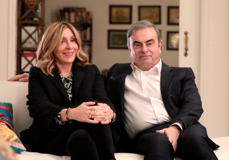 Former Nissan chairman Carlos Ghosn and his wife Carole Ghosn talk during an interview with Reuters in Beirut