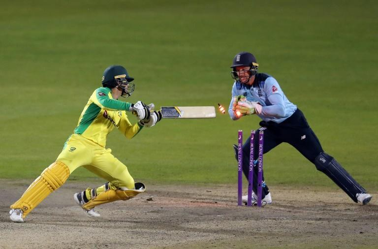 Jos Buttler (R) stumps Alex Carey to complete England's win over Australia in the second ODI
