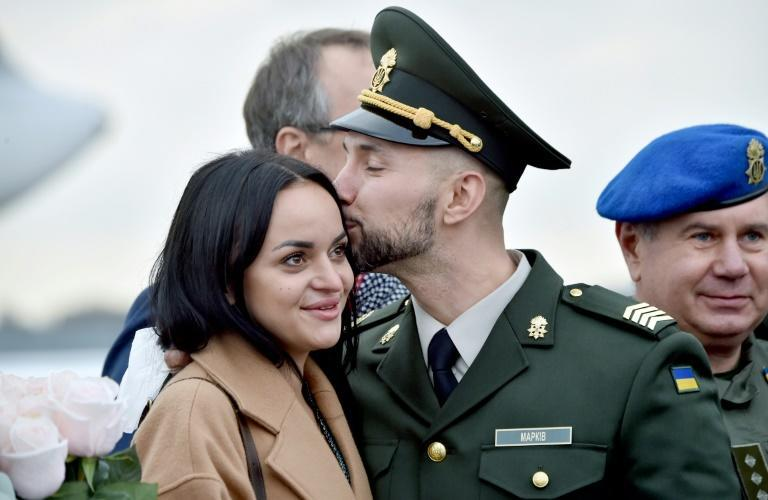 Ukrainian National Guard serviceman Vitaliy Markiv kisses his wife Diana Markiv during a ceremony for his arrival in Kiev, on November 4, 2020