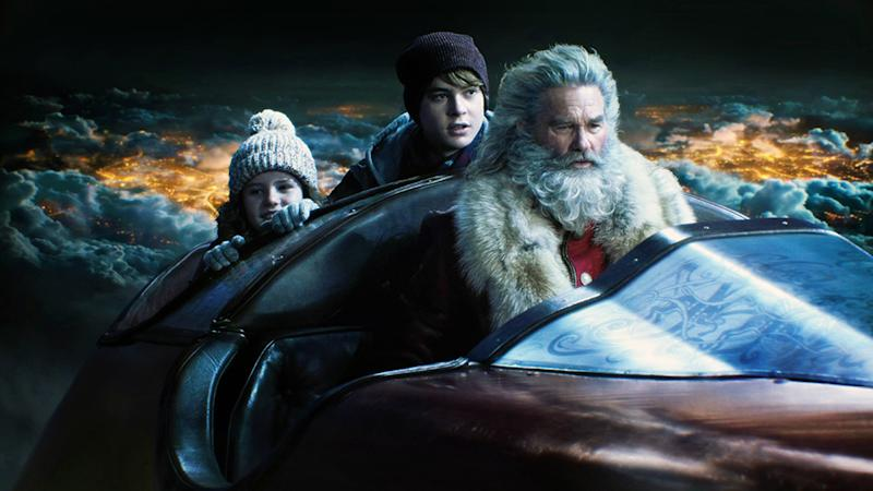 THE CHRISTMAS CHRONICLES, from left: Darby Camp, Judah Lewis, Kurt Russell as Santa Claus, 2018. ph Michael Gibson/ © Netflix / courtesy Everett Collection