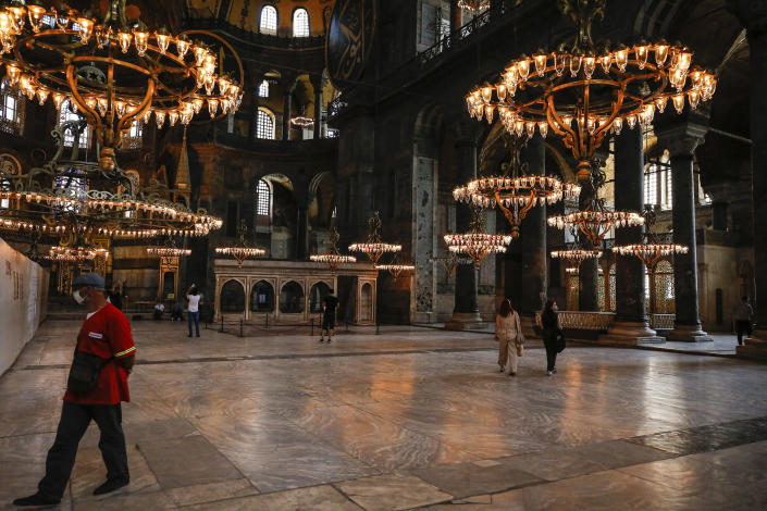 Image: People visit the Byzantine-era Hagia Sophia, one of Istanbul's main tourist attractions in the historic Sultanahmet district of Istanbul (Emrah Gurel / AP)