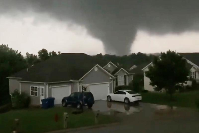 This still image taken from video provided by Chris Higgins shows a tornado in Carl Junction, Mo., on Wednesday, May 22, 2019. The tornado caused damage in the town about 4 miles (6.44 kilometers) north of the Joplin airport. (Chris Higgins via AP) ORG XMIT: CAET599