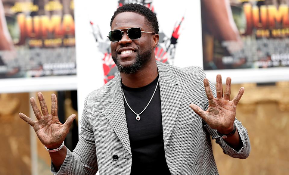 Actor Kevin Hart shows his hands after placing them in cement at a ceremony in the forecourt of the TCL Chinese theatre in Los Angeles, California, U.S., December 10, 2019. REUTERS/Mario Anzuoni