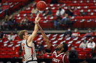 Texas Tech's Mac McClung (0) shootsover Troy's Kieffer Punter (0) during the first half of an NCAA college basketball game Friday, Dec. 4, 2020, in Lubbock, Texas. (AP Photo/Brad Tollefson)