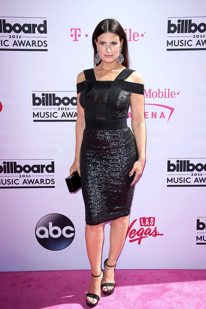 <p>Always perfectly polished,<i> Frozen'</i>s Menzel, presenting tonight, worked a sleek center part with an anything but basic LBD. (<i>Photo: REX/Shutterstock)</i></p>