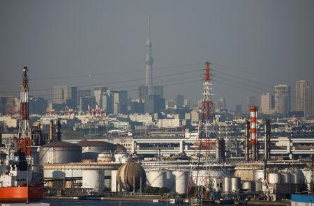 Chimneys of an industrial complex and Tokyo's skyline are seen from an observatory deck at an industrial port in Kawasaki