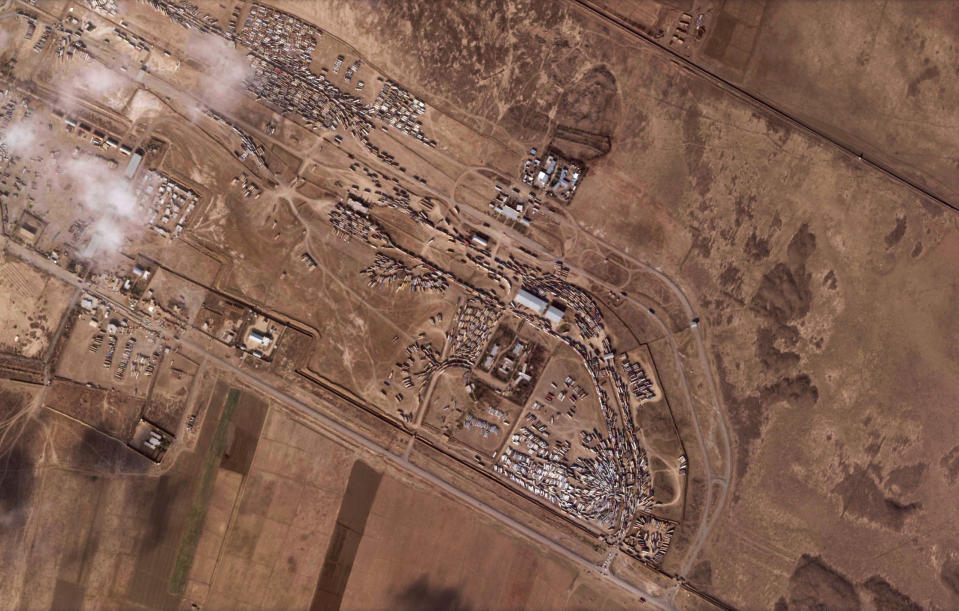 A Dec. 8, 2020, satellite photo from Planet Labs Inc. shows Islam Qala border crossing in Afghanistan's Herat province. New satellite photos analyzed Tuesday, Feb. 16, 2021, by The Associated Press show the devastation after a series of explosions and fires on Saturday, Feb. 13, 2021, consumed hundreds of fuel tankers at the same site on the Afghan-Iranian border. (Planet Labs Inc. via AP)