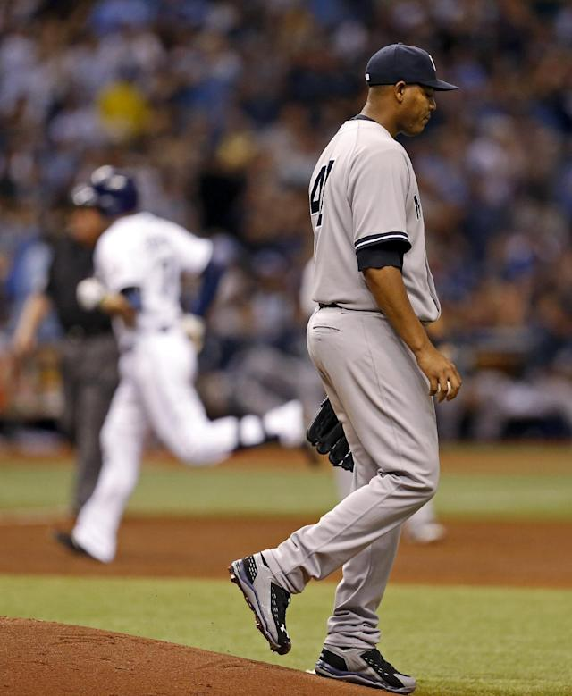 New York Yankees starting pitcher Ivan Nova reacts to giving up a two-run home run to Tampa Bay Rays' Evan Longoria during the third inning of a baseball game, Saturday, April 19, 2014, in St. Petersburg, Fla. (AP Photo/Mike Carlson)