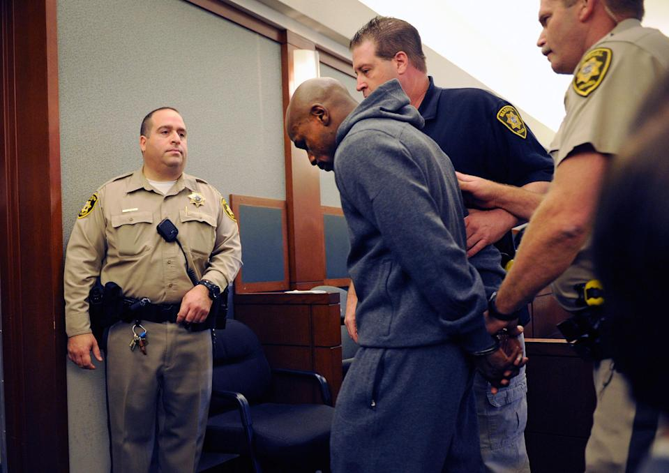 Boxer Floyd Mayweather Jr. is lead away in handcuffs at the Clark County Regional Justice Center as he surrenders to serve a three-month jail sentence at the Clark County Detention Center on June 1, 2012 in Las Vegas, Nevada. (Photo by David Becker/Getty Images)