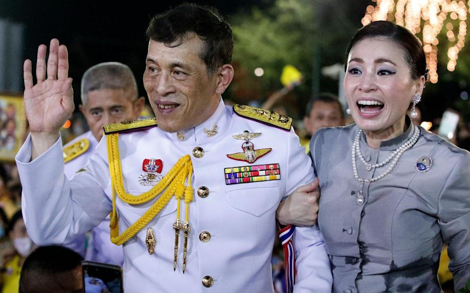 The Thai king and queen greet supporters outside their Bangkok palace - Rungroj Yongrit/EPA-EFE/Shutterstock