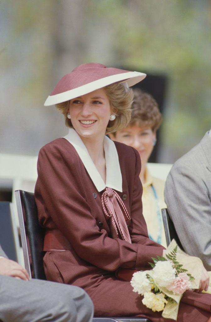 <p>This Catherine Walker dress, paired with a matching Frederick Fox hat, blended sailor styles with suiting for a perfectly British look (though that might have been lost on those around her, as she wore it during her 1986 trip to Canada).<br></p>