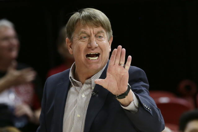 North Carolina State coach Wes Moore directs players during the first half of the team's NCAA college basketball game against Louisville in Raleigh, N.C., Thursday, Feb. 13, 2020. (AP Photo/Gerry Broome)