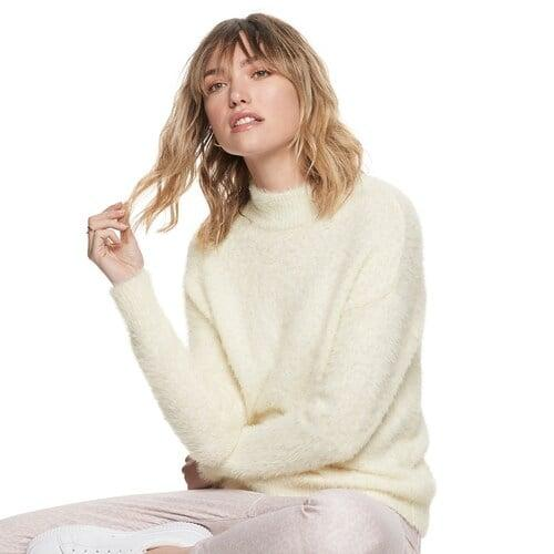 """<p>""""A texture like this <a href=""""https://www.popsugar.com/buy/POPSUGAR-Fuzzy-Mockneck-Sweater-523291?p_name=POPSUGAR%20Fuzzy%20Mockneck%20Sweater&retailer=kohls.com&pid=523291&price=25&evar1=fab%3Aus&evar9=46947571&evar98=https%3A%2F%2Fwww.popsugar.com%2Fphoto-gallery%2F46947571%2Fimage%2F46947592%2FPOPSUGAR-Fuzzy-Mockneck-Sweater&list1=popsugar%20at%20kohls&prop13=api&pdata=1"""" rel=""""nofollow"""" data-shoppable-link=""""1"""" target=""""_blank"""" class=""""ga-track"""" data-ga-category=""""Related"""" data-ga-label=""""https://www.kohls.com/product/prd-3940196/womens-popsugar-fuzzy-mockneck-sweater.jsp?color=Primrose%20Pink&amp;prdPV=7"""" data-ga-action=""""In-Line Links"""">POPSUGAR Fuzzy Mockneck Sweater</a> ($25, originally $50) instantly adds a luxurious vibe to your wardrobe. I'll be wearing mine with vegan leather trousers and mules for a holiday party.""""</p>"""