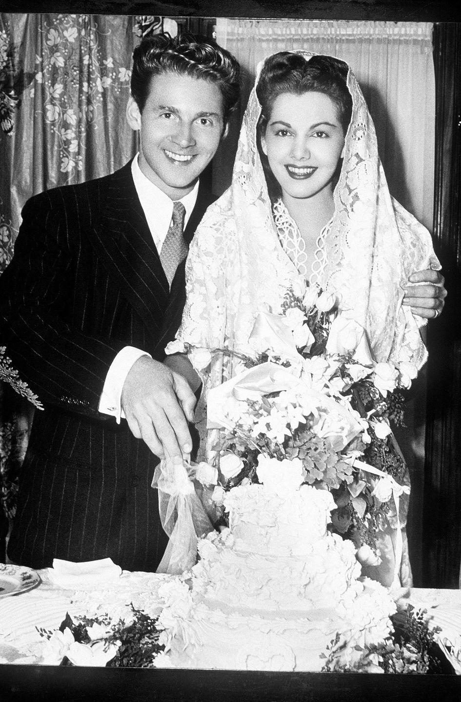 <p>Dominican actress Maria Montez wore a hooded lace veil over her wedding dress for her second marriage to French actor Jean-Pierre Aumont in 1943. The couple welcomed their first child, Tina Aumont, in 1946 and were married until Montez's sudden death in 1951. </p>