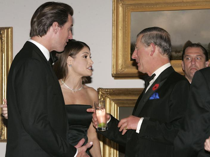 San Francisco Mayor Gavin Newsom and Kimberly Guilfoyle Newsom speak with Prince Charles in a gallery of the De Young Museum in November 2005 during the prince's visit to San Francisco, CA.