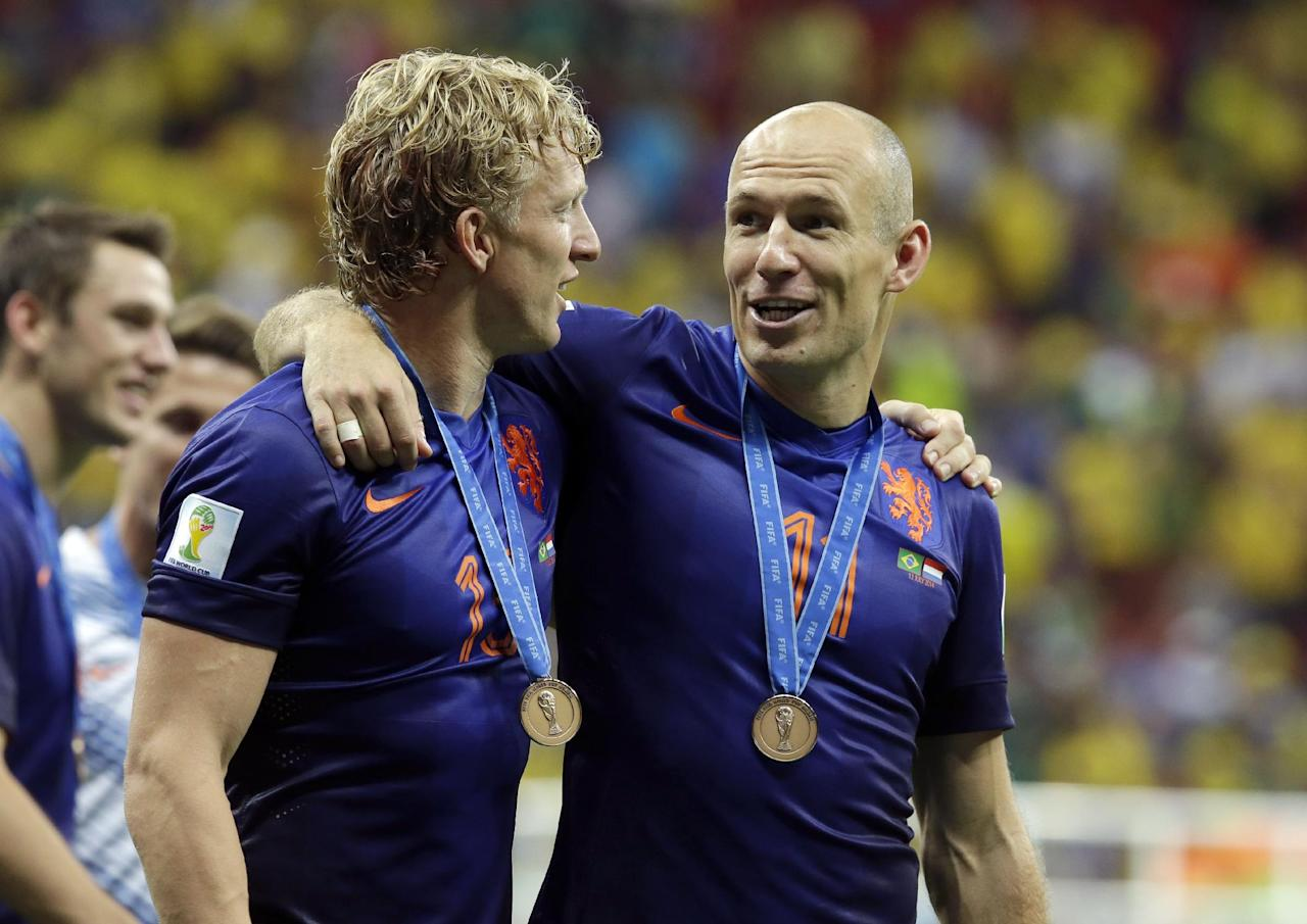 Netherlands' Dirk Kuyt, left, and Arjen Robben celebrate after the World Cup third-place soccer match between Brazil and the Netherlands at the Estadio Nacional in Brasilia, Brazil, Saturday, July 12, 2014. The Netherlands won the match 3-0. (AP Photo/Hassan Ammar)