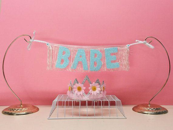 """Get it <a href=""""https://www.etsy.com/listing/232375938/babe-glittering-fringe-banner-wall?ref=shop_home_active_23"""" target=""""_blank"""">here</a>."""