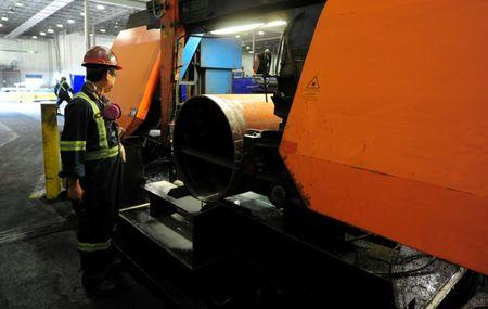 FILE PHOTO: Workers are seen at Bri-Steel Manufacturing, a manufacturer and distributer of seamleass steel pipes, in Edmonton