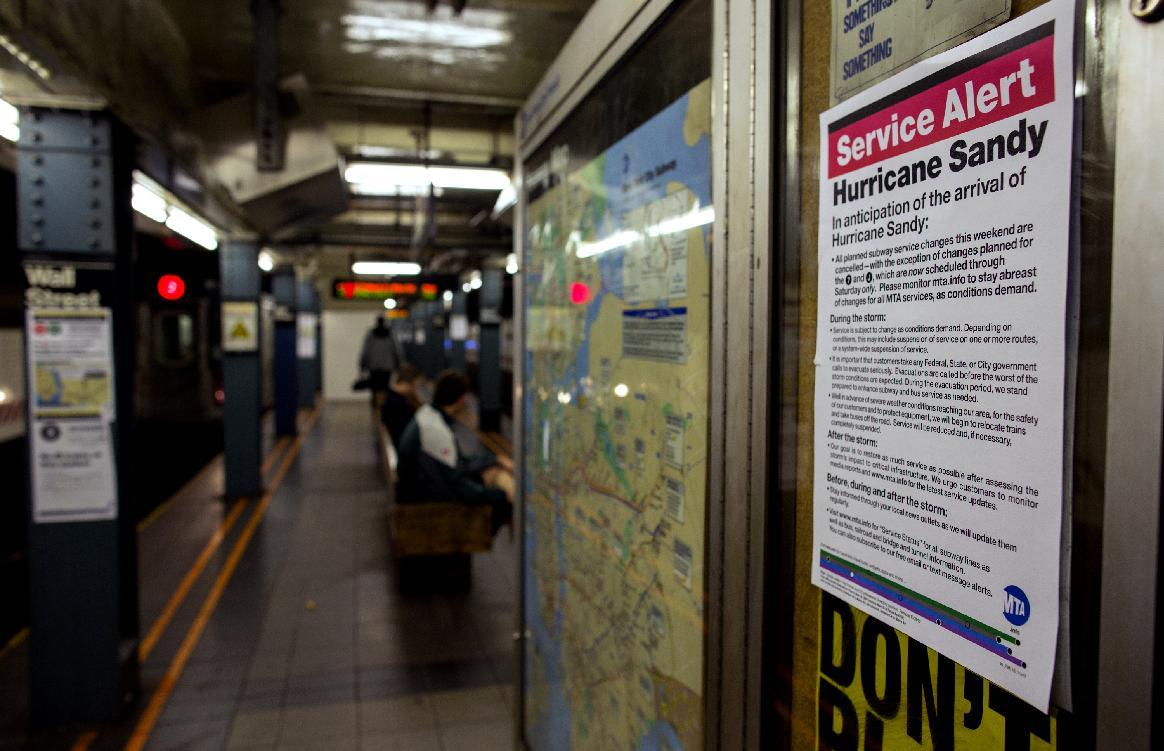 A sign informs subway riders of changes in service in the hours before the arrival of Hurricane Sandy in New York Sunday, Oct. 28, 2012. Areas in the Northeast Region prepared Sunday for the arrival of the hurricane and a possible flooding storm surge. (AP Photo/Craig Ruttle)