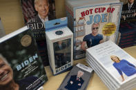 """A display of President-elect Joe Biden and Jill Biden books and keepsakes including a """"Hot Cup of Joe,"""" coloring book, are available at Browseabout Books, Friday, Nov. 13, 2020, in Rehoboth Beach, Del. (AP Photo/Alex Brandon)"""