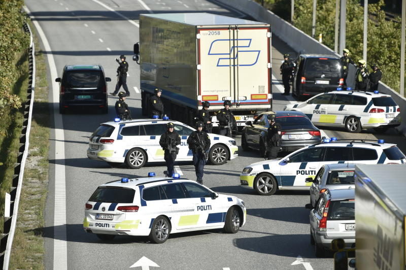 Danish police block transport links in hunt for 'three' in black vehicle