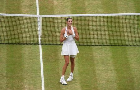 Tennis - Wimbledon - London, Britain - July 15, 2017   Spain's Garbine Muguruza celebrates winning the final against Venus Williams of the U.S. REUTERS/Facundo Arrizabalaga/Pool