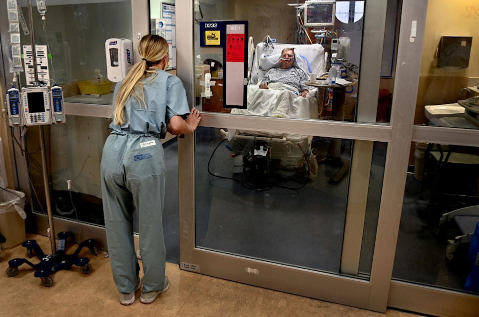 Nurse Paige Thompson, checks in on Covid-19 patient in a Covid ward at Tampa General Hospital in Tampa, Florida on August 19, 2020. Source: Getty