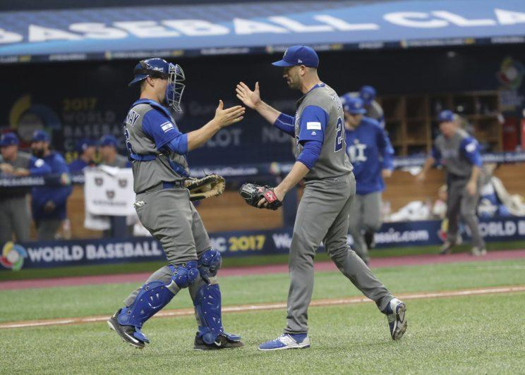 Israel's pitcher Josh Zeid, right, celebrates his team's victory with catcher Ryan Lavarnway against South Korea after the first round game of the World Baseball Classic at Gocheok Sky Dome in Seoul, South Korea, Monday, March 6, 2017. (AP Photo/Lee Jin-man)