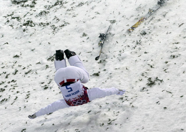 Canada's Travis Gerrits crashes on landing during men's freestyle skiing aerials qualifying at the Rosa Khutor Extreme Park, at the 2014 Winter Olympics, Monday, Feb. 17, 2014, in Krasnaya Polyana, Russia. (AP Photo/Andy Wong)