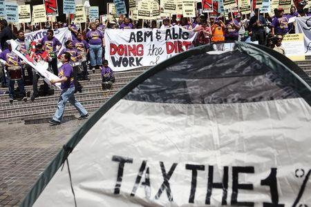 Activists, labor unions and Occupy LA protestors gather at Bank of America Plaza on Tax Day in Los Angeles