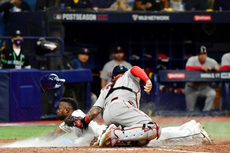 Tampa Bay's Randy Arozarena steals home in the Rays' 5-0 victory over the Boston Red Sox in game one of their American League division series (AFP/Julio Aguilar)
