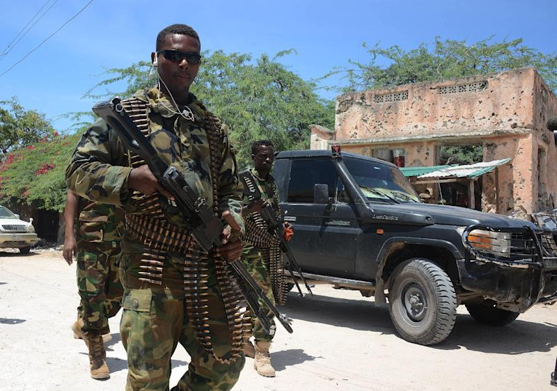 File picture shows Somali soldiers on patrol in the Wadajir district south of capital Mogadishu on August 15, 2014