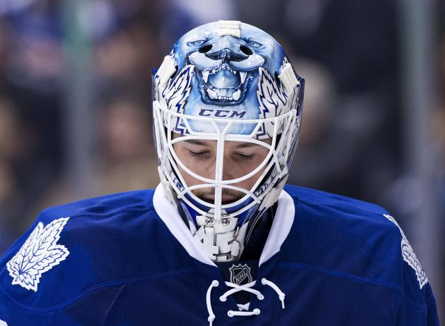 Toronto Maple Leafs goalie Jonathan Bernier looks on while playing St. Louis Blues during first period NHL hockey action in Toronto on Tuesday, March 25, 2014. (AP Photo/The Canadian Press, Nathan Denette)